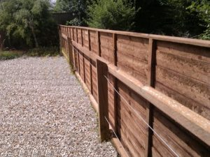 Fence panels added to wire fence.