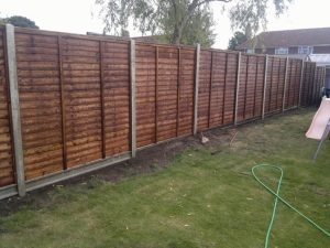 Concrete posts and fence panels.